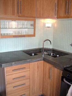 Undermount Kitchen Sink On Kitchen With Custom Concrete Countertops And A Corner Undermount Sink
