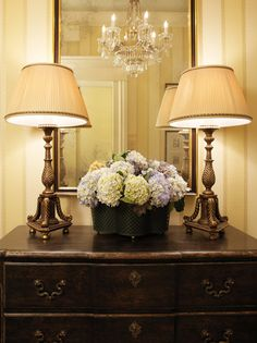 Entry hall small dresser with matching lamps...so pretty.  Via Rooney Robison Antiques