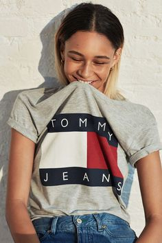 A retro graphic T-shirt like this one from Tommy Hilfiger and Urban Outfitters looks perfect with high-waisted jeans.