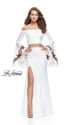 37a9908046 TweetEye catching two piece long sleeve off the shoulder dress. Featuring  bell sleeves with floral applique and a side leg slit. Back zipper closure.