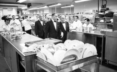 <strong>Not published in LIFE.</strong> Frank Sinatra and his friends, including comedian Joe E. Lewis, take a shortcut through the kitchen to get to the stage of Miami's Eden Roc Resort in 1958.