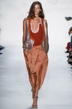Very cool colorblocking with carrot and mauve and I really like the mix in of metallic with the vest.  Diane von Furstenberg Spring 2013 RTW - Review - Collections - Vogue