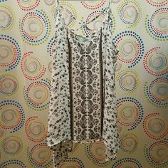 Floral Maurices White Cami Tank Brand new without tags. I just did not like the way it looked on me. Size XL Any questions just ask. Maurices Tops Camisoles
