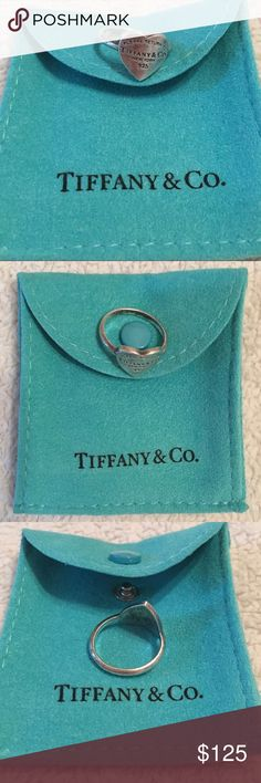 Tiffany & Co Return to Tiffany Heart Ring The classic Tiffany & Co Return to Tiffany heart ring in the authentic Tiffany & Co blue jewelry pouch as pictured above. The perfect gift for yourself or for a loved one! Tiffany & Co. Jewelry Rings