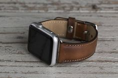Genuine leather iwatch strap. Size: Long Track: Wide: 0.78 (2 cm), Length: 4.92 (12.5 cm) Short Track: Wide: 0.78 (2 cm), Length: 3.42 (8.7 cm)  Band size: 38 mm or 42 mm  Four different color options for adapters (Silver, Black, Rose Gold, Gold).  Express shipping: Shipping to US takes 2-4 business days, Europe 1-2 business days via DHL.  Best gift for birthday, graduation, anniversary, wedding or Valentine's day.  Our products are premium quality handmade leather goods. All of the leathers…
