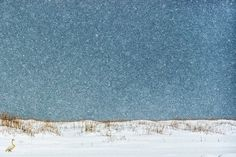 Italian Photographer and Iceland Review cooperator Elisabetta Rossowon a National Geographic competition for her photo of a swan in the snow.