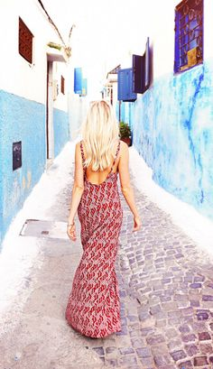 Long, low-back red printed dress