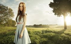 Lady in the field by Federico Chiesa - A lady in a field.