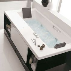 The Keops Evolution series feature functional drawers and shelves around the bathtub itself. An elegant way to add product/towel storage.
