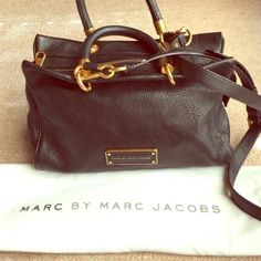 """MARC by Marc Jacobs Too Hot To Handle Zip Satchel Reposh. Dual rolled top handles. Detachable cross body strap. Flat bottom with hardware feet to protect bag when set down. Top zip closure. Back wall sip pocket and multifunctional slip pockets. Comes with dust bag. 11.5"""" bottom width. 4.5"""" depth. 8"""" length. 5"""" handle drop. 22.5"""" detachable strap drop.  Bag has some signs of wear and scratches on bottom feet. I do not trade! Marc by Marc Jacobs Bags Satchels"""