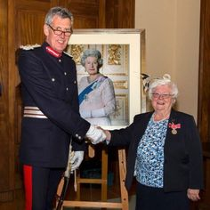 An Exmouth community champion says she will never forget two days in which she attended a Buckingham Palace garden party and received the British Empire Medal.
