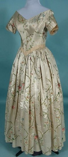 == RARE c. 1837 Gown (as dated by Nancy Rexford, costume historian and author) Museum Deaccessioned Ivory Silk Satin Embroidered Floral Gown. ==