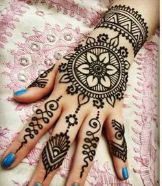 Detailed Mehndi designs for Back of the hand