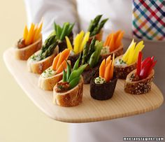 Party Frosting: appetizers - Cut a bagette on angle, scoop out a little and put dip and veggies inside!