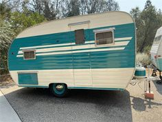 This is a fully restored 1955 Gibson 14 ft travel trailer. It has an original icebox, gas stove, countertop, tabletop, and wooden screen door! This trailer was...