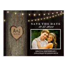 """Photo Rustic Carved Oak Tree Save The Date Cards - features a barn wood background, string lights and an oak tree that you can """"carve"""" your wedding date and initials into.  The front also features a demo couple photo that you can change to the picture of your choice. The back has a printed burlap looking vector with chalkboard text tags."""