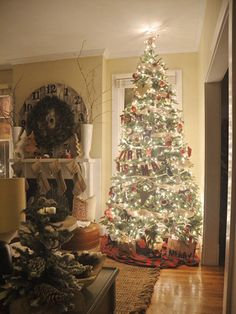 A mix of ornaments, including fair isle patterns and knit critters, give the Christmas tree a woodland touch.
