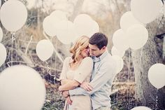 engagement shoot prop. balloons, and lots of them! make sure they have weights so they don't float away. make sure the ribbons are at various heights, most of which should be taller than you.