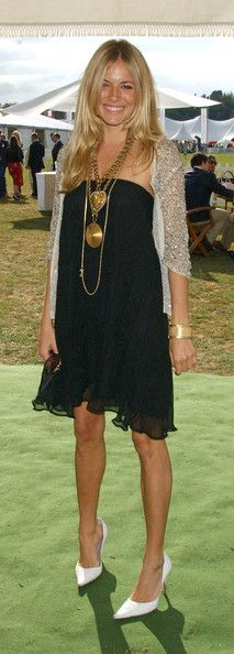 Sienna Miller look relaxed in a black strapless dress with a frilly hemline.
