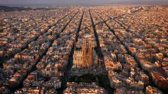 Offering a whole new perspective on travel photography, Amos Chapple takes aerial images of European cities and historic sites using a camera mounted on a quadcopter drone. Here are some of the stunning birds eye views, including this one of the Eixample district of Barcelona.