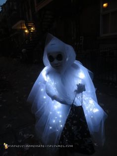 My 6 1/2 year boy designed this ghost costume. He said he wanted light on it to appear as if he was floating in the dark. I made the costume using ...