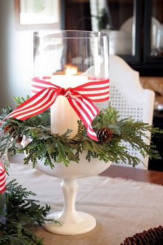 This would make a great Christmas centerpiece; milk glass, greenery, candle and ribbon.  Now -- I need to talk my brother out of Granny's milk glass bowl!