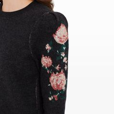 Crafted in 100% merino wool, the Poelle features sweet puff sleeves with a Victorian-inspired floral motif. Pair it with tailored trousers for a balance of softness and structure. Merino wool Straight fit 21 ½'' in length, based on a size S Rounded neck; puff sleeves; charcoal sweater with floral intarsia; rib knit trim on collar, cuffs, and hem Dry clean Imported