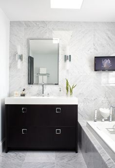 marble tile wall & floor, ebony vanity with square pulls, quartz countertop