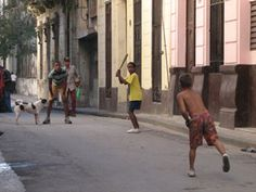 I love this action pic of kids playing baseball on the street in Cuba