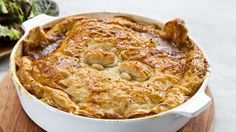 Flavoursome+and+always+a+winner+with+the+kids,+this+easy+veggie-packed+chicken+pie+recipe+ups+the+comfort+factor+by+adding+in+a+sneaky+layer+of+cheese+right+before+you+cap+it+off+with+flaky+puff+pastry.