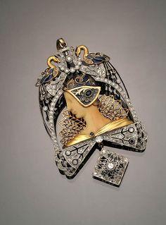 Enamel, platinum, ivory, sapphires, gold & diamonds pendant brooch, 1920
