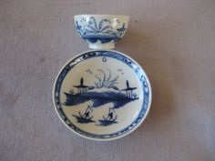 """A Caughley miniature tea bowl and saucer painted in blue with the  """" Island"""" pattern  S mark to tea bowl Circa 1780Width of saucer  2 3/4"""""""