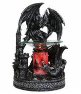 "Black Dragon polyresin oil warmer. The glass dish holds the scented oil. Red cylinder gives the warmer a unique look when plugged in. 35 watt halogen bulb heats the oil to release its scent. The power cord has a built in on/off switch and a dial to control the intensity of the heat. Measures approximately 8"" h x 5""w"