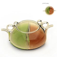 """The Yin & Yang is a teapot designed for two people. So if one person prefers green and the other prefers red – you can prepare both of them inside this teapot . The spouts even double as the handle. Cool idea and looks quite beautiful too. Great opportunity here to show very contrasting teas."""