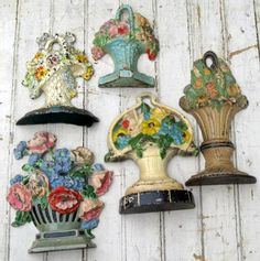 I love these old cast iron door stops, especially the flower baskets...