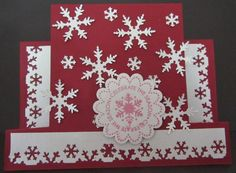 Snowflake red and white Christmas card. Made using step card die from The Stamp Doctor (love how easy it is to use) and snowflake border punch from EK Success. The large snowflakes are from a punch. The greeting is from Stampin' Up, and was punched using their scallop punch.