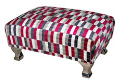 Small footstool upholstered in Underground fabric, standing on chrome legs.