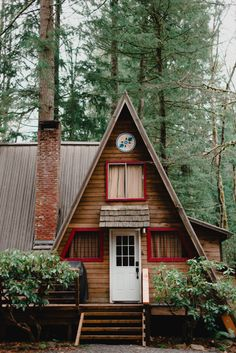 A sweet cabin in the woods with a metal roof for protection and longevity