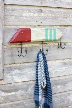 "Fashioned after classic buzzbait fishing lures, this wooden coat hook is the perfect adornment for your lake house or hunting camp entryway. It's sure to catch any avid fisherman, hook, line, and sinker!22½"" x 10""t"