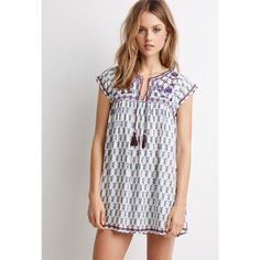 """NEW Embroidered Peasant Mini Dress New with tags. I normally wear Medium and I did size up to Large because of the length. Features all over floral print with embroidered yoke, mirrored accents and a self tie tasseled neckline. Unlined. 100% rayon. Bust: 19.5"""", Length: 32"""" Dresses Mini"""