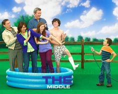 The Middle - with extreme exaggeration it describes the average American family! It's hilarious!