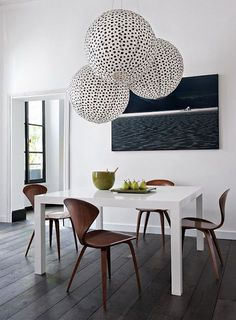 These huge hanging round collection of lights make a stunning focal point for this stylish dining room - don't forget to always group in odd numbers!