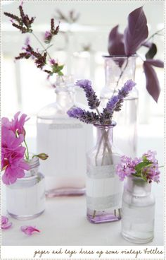 Tape lace and tracing paper around recycled glass bottles to make small vases.