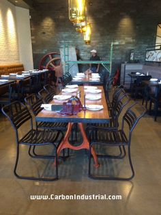 Reclaimed wood dining table, steel edging and cast iron legs made by Carbon Industrial design for NYAJ restaurant.