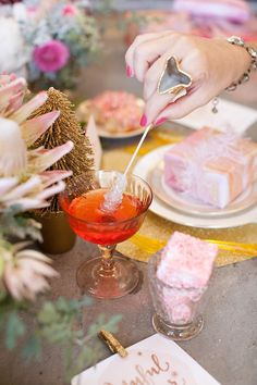 Cotton candy champagne with a rock candy swizzle stick | Photo by Katie Beverley | Styling by Art in the Find