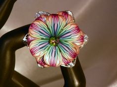 http://www.artfire.com/uploads/product/0/190/45190/4645190/4645190/large/ring_-_multi_colored_petal_ring_6be67640.jpg