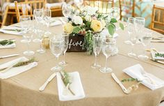 rustic reception tables with burlap and natural florals / photo by angelawinsorphotography.com