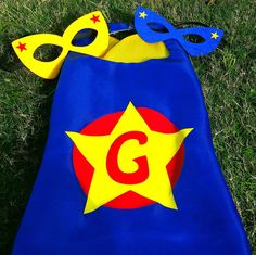 Kids Capes, personalized superhero cape, Green satin cape with a blue liner, blue circle & yellow star vinyl design****MASK SOLD SEPARATELY by TheCapeLady on Etsy #superherocapes #superheromask #kidscostume #superheroparty #dressup