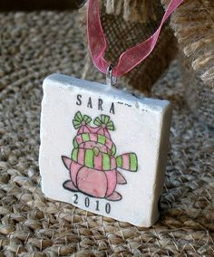 Personalized ornament - looks like they printed it on a 2x2 marble tile and attached a hanger!  Great idea for expanding your product line - printable with LogoJET Printers.