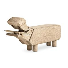 The hippo - designed by Kay Bojesen - is a stylish decorative Danish wooden classic design piece as well as a box for pencils. From the Danish company Rosendahl. Small wooden pencils are included. (I'm disappointed. I wanted its mouth to be hole punch and it to have a pencil sharpener in mouth so that the shavings come out from its butt... :-( )